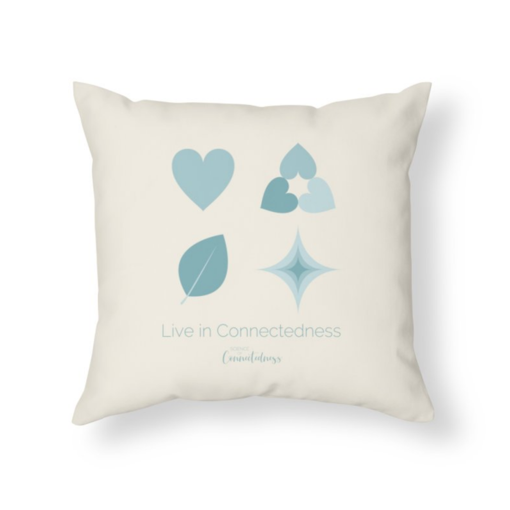 "Linen colored pillow with SofC icons in square. ""Live in Connectedness"""