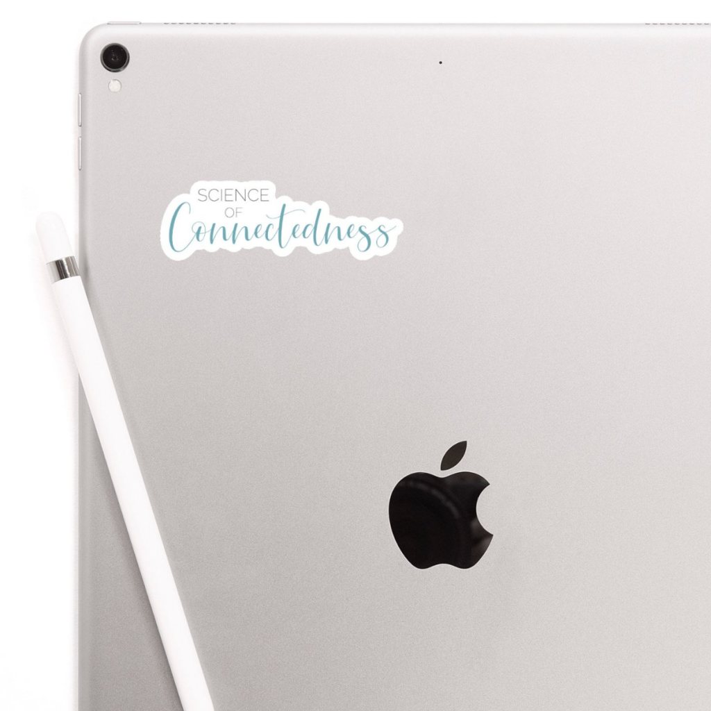 iPad with Science of Connectedness logo sticker on back