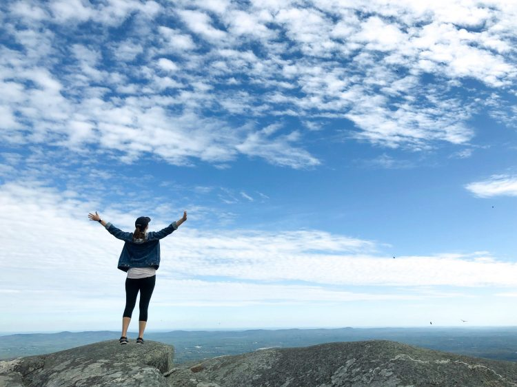 arms open to the sky on Mt. Monadanock