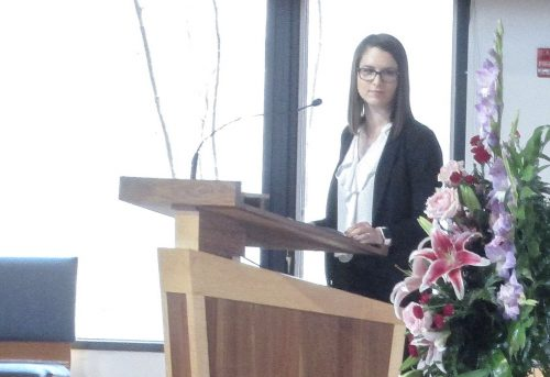 Picture of Sarah E. K. Lentz leading memorial service